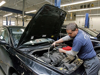 Mike Cutrera makes repairs in the service department of Cherry Hill Volvo, where he has worked 22 years.