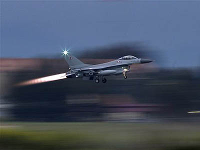 A Danish F-16 takes off from the NATO airbase in Sigonella, Italy, Monday. The European Union´s top foreign policy official brushed aside concerns Monday that the coalition supporting military action against Libyan leader Col. Moammar Gadhafi is already starting to fracture. (Andrew Medichini / AP Photo)