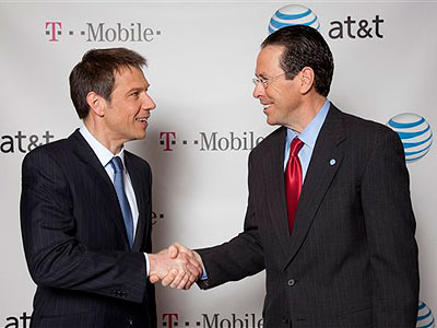 Deutsche Telekom Chairman and CEO Rene Obermann, left, and AT&T Chairman and CEO Randall Stephenson pose for photos in March after a cash-and-stock deal valued at $39 billion that would make AT&T the largest cellphone company in the U.S. (AP Photo / Newscast, Mark Dye)