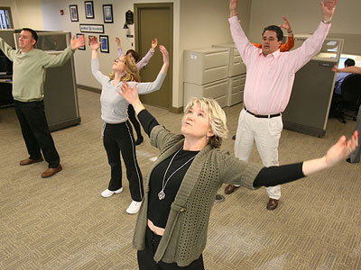 Charon Planning is a small company that provides some unusual perks to workers, including T´ai Chi classes and on-site massages. Christina Carter, center, and other employees take part in a T´ai Chi class. (Charles Fox / Staff Photographer)