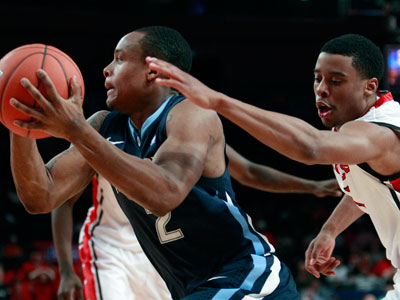 Villanova´s Maalik Wayns drives past Rutgers´ Jerome Seagears. (AP Photo/Frank Franklin II)