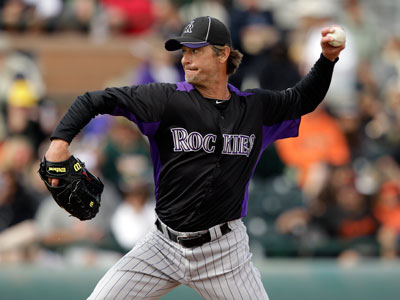 Colorado Rockies pitcher Jamie Moyer throws to the San Francisco Giants during a spring training game. (AP Photo/Marcio Jose Sanchez)