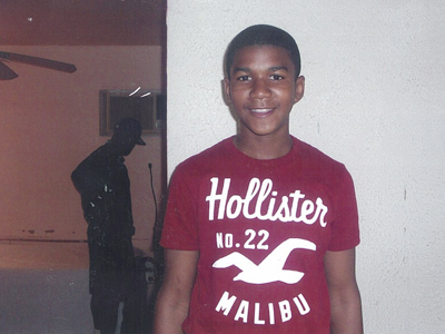 Trayvon Martin poses for a family photo.