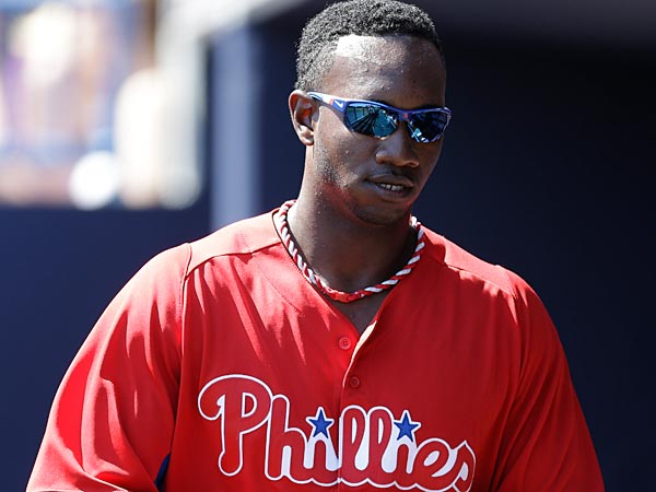Philadelphia Phillies right fielder Domonic Brown (9) in the duguout in a spring training baseball game at Steinbrenner Field in Tampa, Fla., Saturday, March 16, 2013. (AP Photo/Kathy Willens)