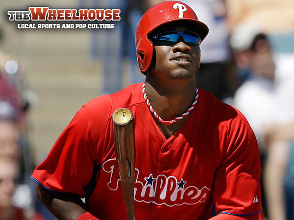 Philadelphia Phillies Domonic Brown watches his 3-run home run off New York Yankees starting pitcher Hiroki Kuroda during the fourth inning<br />of a spring training baseball game at Steinbrenner Field in Tampa,<br />Fla., Saturday, March 16, 2013.  (AP Photo/Kathy Willens)