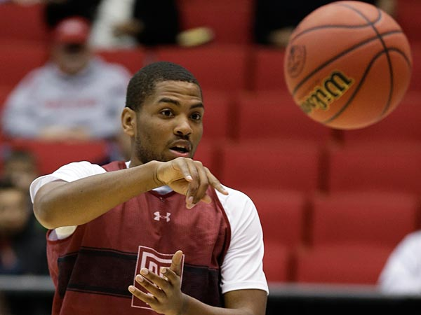 Temple guard Khalif Wyatt passes the ball during practice at the NCAA college basketball tournament, Thursday, March 21, 2013, in Dayton, Ohio. Temple plays North Carolina State in a second-round game Friday. (AP Photo/Al Behrman)