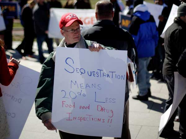 A protest against the federal budget cuts called sequestration was held at Independence National Historic Park on Wednesday by government workers, union members and other activists. (Matt Rourke / Associated Press)