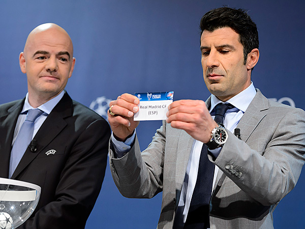 Former Real Madrid star Luis Figo pulled out his old team´s name at the UEFA Champions League draw. (Laurent Gillieron/Keystone/AP)