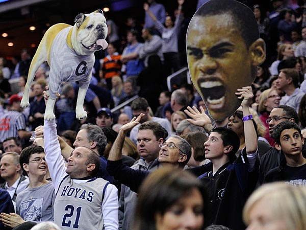 Georgetown fans cheer during the second half of an NCAA college basketball game against Syracuse, Saturday, March 9, 2013, in Washington. Georgetown won 61-39. (AP Photo/Nick Wass)