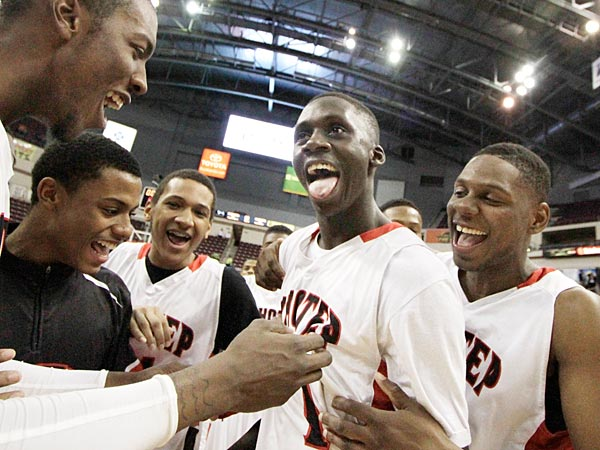 (L-R) Imhotep Charter&acute;s (21) Dymir Logan, (1) Brandon Austin and (5)<br />Nigel Grant celebrate after their win over Archbishop Carroll. (Elizabeth Robertson/Staff Photographer)