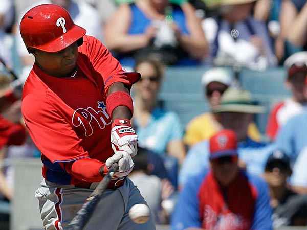 Philadelphia Phillies shortstop Yuniesky Betancourt connects on a fourth-inning RBI single against the New York Yankees in a spring training exhibition baseball game in Tampa, Fla., Saturday, March 16, 2013. The Phillies won 7-0. (AP Photo/Kathy Willens)