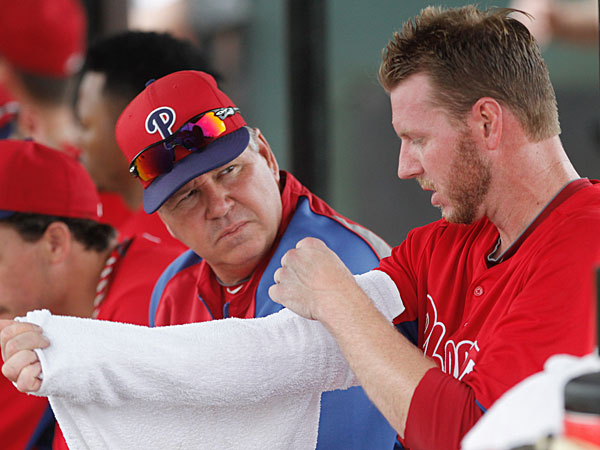 Phillies pitching coach Rich Dubee, left, listens to phillies pitcher<br />Roy Halladay, right, as he wraps his arm in between innings of the<br />minor league game he pitched on Saturday in at the Carpenter Complex in Clearwater. 03/23/2013  (Michael Bryant/Staff Photographer)