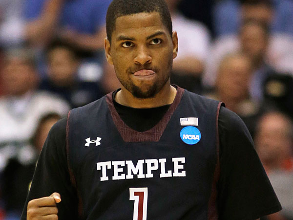 Temple guard Khalif Wyatt clinches his fist as he walks up court<br />during the second half of a second-round game against the North<br />Carolina State at the NCAA college basketball tournament, Friday,<br />March 22, 2013, in Dayton, Ohio. (Al Behrman/AP)