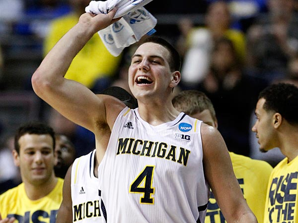 Michigan forward Mitch McGary (4) cheers on his teammates in the final minutes of their 71-56 win over South Dakota State in a second-round game of the NCAA men´s college basketball tournament Thursday, March 21, 2013, in Auburn Hills, Mich. (AP Photo/Duane Burleson)