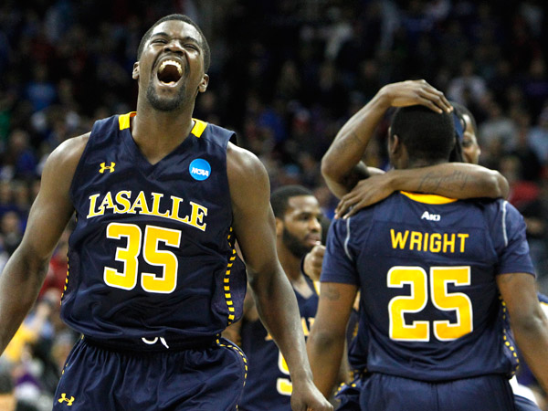 La Salle´s Rohan Brown celebrates as Jerrell Wright is hugged in background after they defeated Kansas State. (Ron Cortes/Staff Photographer)