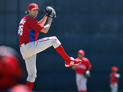 Cole Hamels warms up on the practice field before pitching in a minor league game in Clearwater Tuesday. (David Maialetti / Staff Photographer)