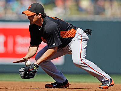 The Giants are reportedly looking to part ways with either Ryan Theriot or Mike Fontenot. (Marcio Jose Sanchez/AP)