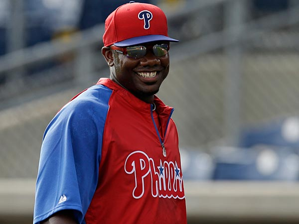 Philadelphia Phillies first baseman Ryan Howard reacts during pregame warmups before a spring training baseball game against the New York Yankees in Clearwater, Fla., Tuesday, March 19, 2013. (AP Photo/Kathy Willens)