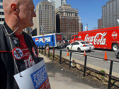Frank Berthcsi , a Coca-Cola forklift operator, protested outside City Hall today. Teamsters drove their soda trucks in circles around City Hall during the rally. ( Tom Gralish / Staff Photographer )