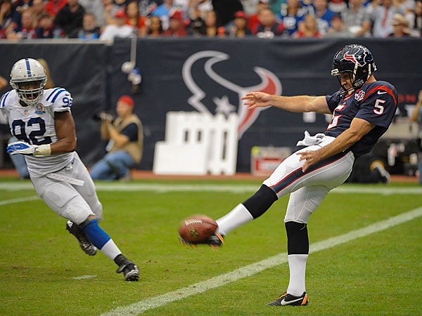 Houston Texans punter Donnie Jones (5) miss kicks a punt as Indianapolis Colts´ Jerry Hughes (92) defends in the second quarter of an NFL football game Sunday, Dec. 16, 2012, in Houston. (AP Photo/Dave Einsel)
