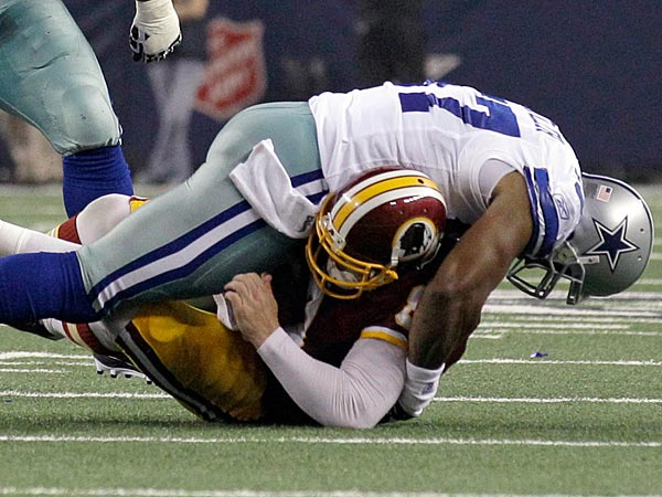 Dallas Cowboys´ Victor Butler sacks Washington Redskins quarterback Rex Grossman during the first half of an NFL football game Monday, Sept. 26, 2011, in Arlington, Texas. (Tony Gutierrez/AP)