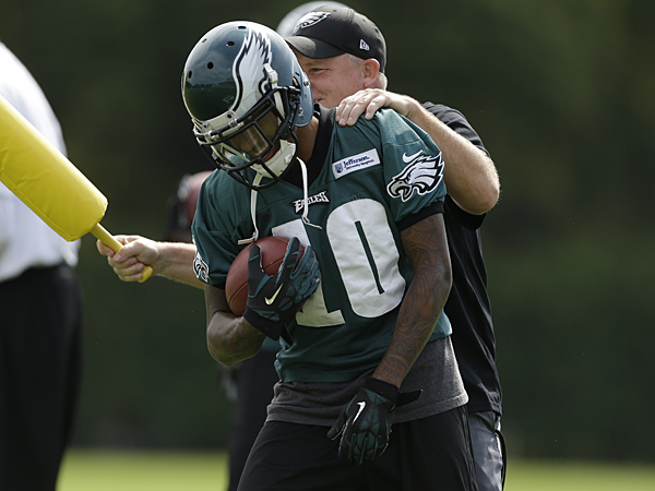 Eagles wide receiver DeSean Jackson and head coach Chip Kelly during practice back in September 2013. (Matt Rourke/AP)
