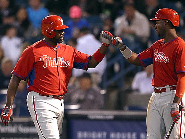 Phillies first baseman Ryan Howard and left fielder Domonic Brown. (Yong Kim/Staff Photographer)
