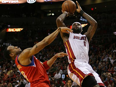 LeBron James and the Heat are looking to make quick work of the Sixers. (AP File Photo)