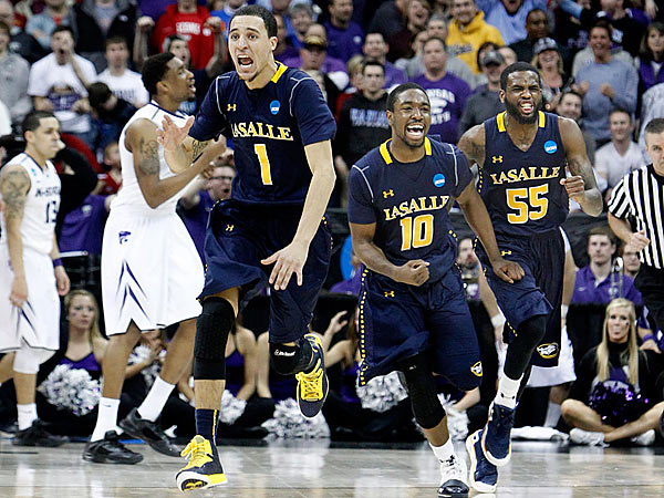 As the final buzzer sounded, La Salle´s D.J. Peterson,Sam Mills, and Ramon Galloway begin to celebrate their victory. (Ron Cortes/Staff Photographer)
