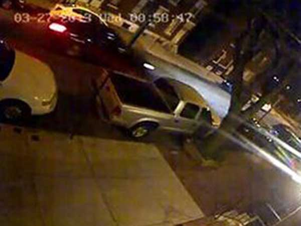 Surveillance video of the car, possibly a black or dark-colored Ford Taurus, believed to be involved in a hit-and-run that injured a Philadelphia police officer.