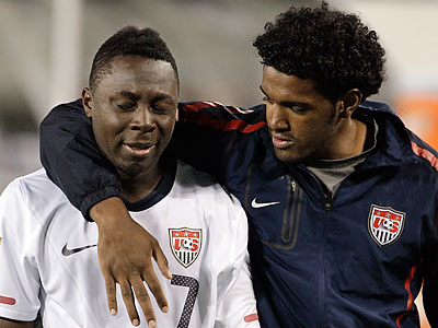 Sheanon Williams consoles Freddy Adu after the U.S.´ elimination from Olympic qualifying. (Mark Humphrey/AP)