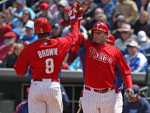 Phillies outfielder Domonic Brown and first baseman Ryan Howard. (Michael Bryant/Staff Photographer)