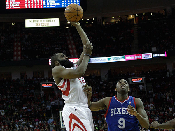 James Harden (13) shoots over Philadelphia 76ers´ James Anderson (9) during the second half of an NBA basketball game on Thursday, March 27, 2014, in Houston. Houston won 120-98. (Bob Levey/AP)
