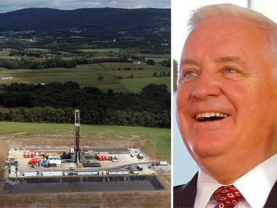 A Marcellus Shale gas drilling site near Latrobe, Pa. Gov. Tom Corbett (right) has said he is open to a fee to aid host communities. (Laurence Kesterson / Staff Photographer)