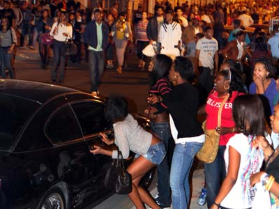 Young people swarmed South Street in a flash mob incident the night of March 20. ((Laurence Kesterson / Staff Photographer)