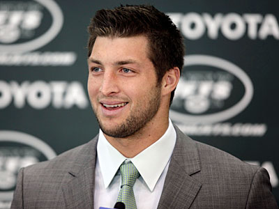 The hype surrounding Tim Tebow has become as much a part of his persona as his game. (Mark Lennihan/AP Photo)
