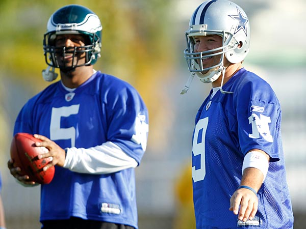 Philadephia´s Donovan McNabb and Dallas´ Tony Romo during the NFC team practice session, in Fort Lauderdale, Fla. Thursday, Jan. 28, 2010, as the team prepares for the Pro Bowl NFL football game that will be played Sunday.(AP Photo/J Pat Carter)