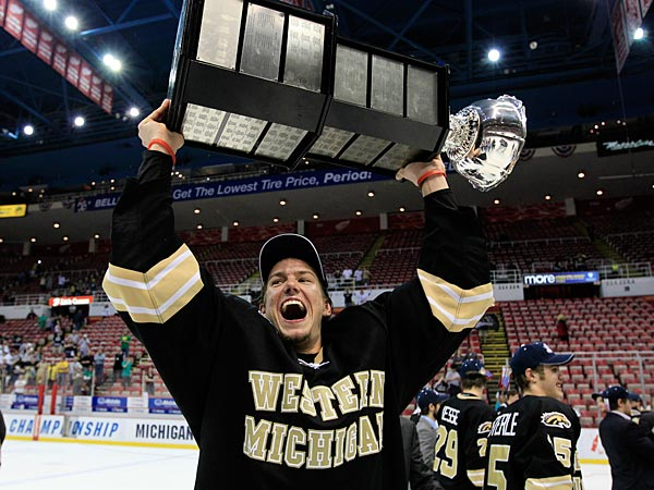 Western Michigan defenseman Dan DeKeyser (5) holds the Mason Cup after defeating Michigan in a CCHA college hockey game in Detroit, Saturday, March 17, 2012. (AP Photo/Carlos Osorio)
