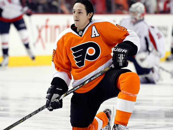 Flyers&acute; Danny Briere kneels on the ice during pre-game warm-ups before<br />the Flyers played the Washington Capitals on Wednesday, February 27,<br />2013.  ( Yong Kim / Staff Photographer )