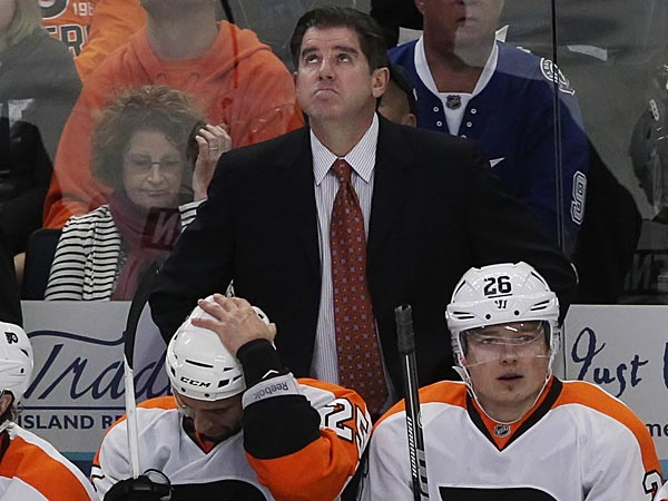Flyers head coach Peter Laviolette seems to be looking for an answer<br />as he checks the clock in the second period. Philadephia Flyers vs<br />Tampa Bay Lightning at the Tampa Tribune Forum. game Action 03/18/2013<br />( MICHAEL BRYANT / Staff Photographer  )