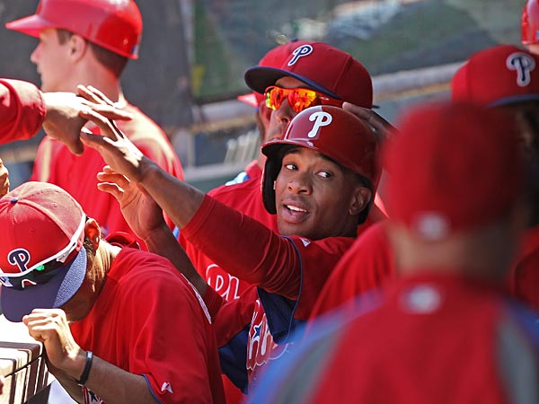 Philadelphia&acute;s Ben Revere, center, is congratulated by his teammates<br />in the dugout, for scoring the first Phillies run in the game.<br />Philadephia Phillies vs Toronto Blue Jays at Bright House Field in<br />Clearwater. The last spring training game of 2013.  Game Action<br />03/28/2013  ( MICHAEL BRYANT / Staff Photographer  )
