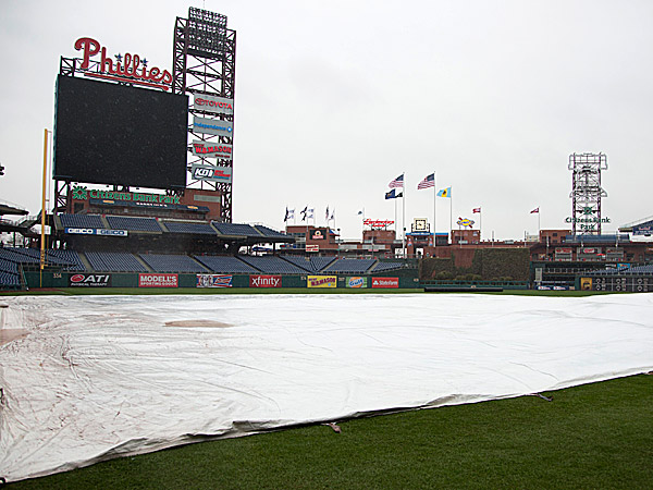 A tarp covers the field at Citizens Bank Park. (Chris Szagola/AP)