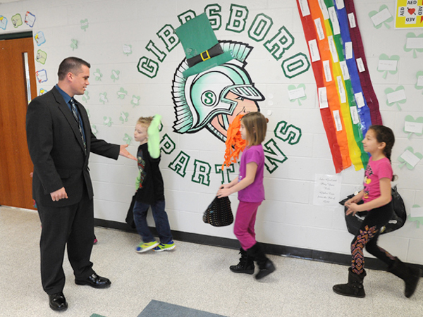 Gibbsboro Elementary School principal Brett Thorp, 35, greets students