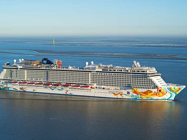"This undated image provided by Norwegian Cruise Lines shows Norwegian Getaway. It will homeport in Miami and its colorful exterior was designed by Miami-based Cuban-American artist David Le Batard, also known as ""LEBO."" (AP Photo/ Norwegian Cruise Lines)"