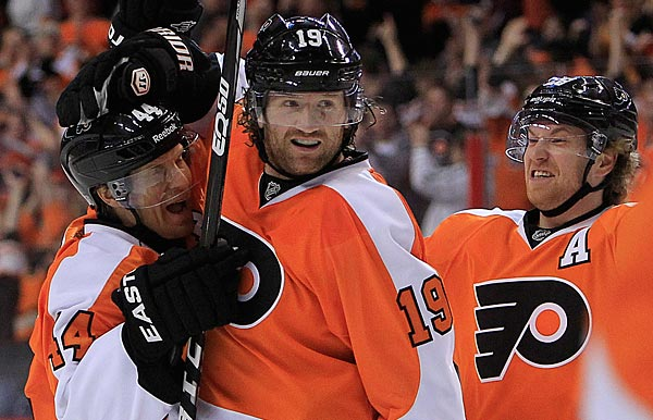 Claude Giroux, Scott Hartnell, and Kimmo Timonen celebrate a power-play goal. (Ron Cortes/Staff Photographer)