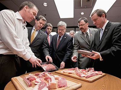 Craig Letch, director of food quality and assurance for Beef Products Inc. (BPI), left, briefs from left: Kansas Gov. Sam Brownback, Texas Gov. Rick Perry, Iowa Gov. Terry Branstad, South Dakota Lt. Gov. Matt Michels and Nebraska Lt. Gov. Rick Sheehy, during a tour in 2012 where the beef product known as pink slime or lean finely textured beef is made. (AP File Photo / Nati Harnik)
