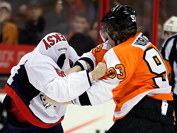 The Capitals´ Steve Oleksy fights with the Flyers´ Jakub Voracek in the third period. (Tom Mihalek/AP)