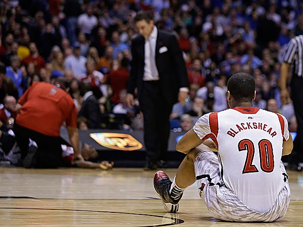 Louisville´s Wayne Blackshear reacts to Kevin Ware´s injury during the first half. (Darron Cummings/AP)