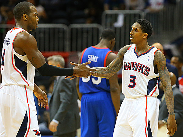 Hawks guard Lou Williams and Paul Millsap. (Curtis Compton/Atlanta Journal-Constitution/AP)
