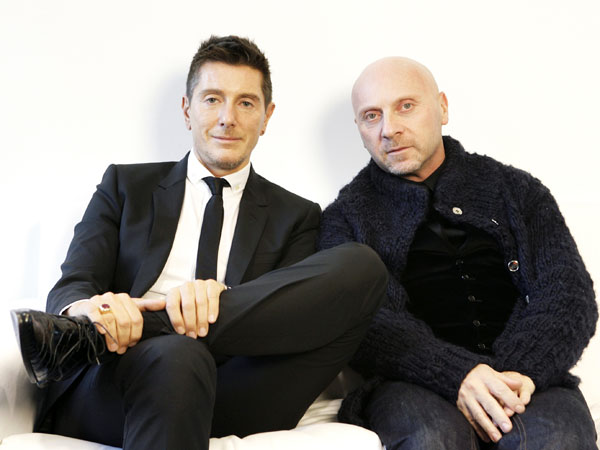 Stefano Gabbana, left, and Domenico Dolce pose for picture during an interview at their showroom in New York, Tuesday, Dec. 4, 2007.  (AP Photo/Seth Wenig)